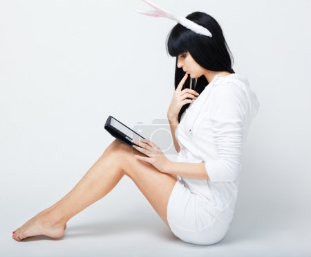 Young woman sitting with tablet pc