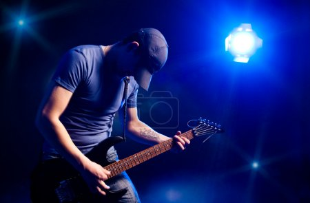 Photo for Man playing on electric guitar - Royalty Free Image