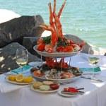 Seafood buffet with an Alaskan King Crab leg cente...