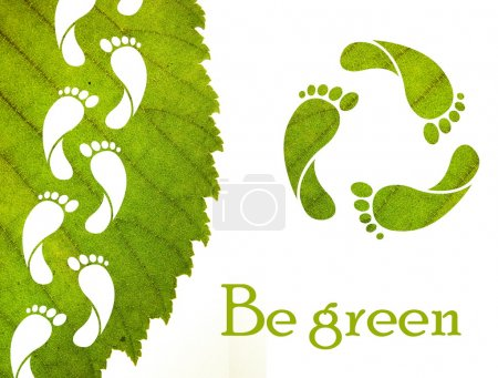 Photo for Footprint recycle sign and green leaf with foot carbon prints - Royalty Free Image