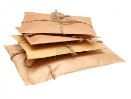 Photo for Brown shipping parcel tied with twine on white - Royalty Free Image