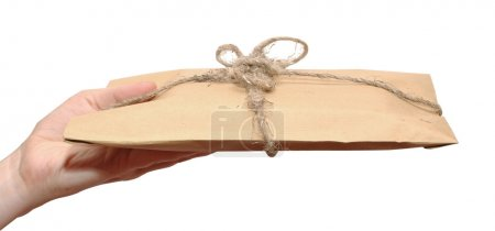 Photo for Hand with brown paper parcels isolated on white - Royalty Free Image