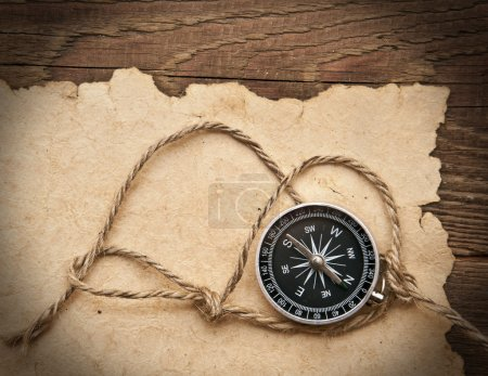 Photo for Compass, rope and old paper on border wood background - Royalty Free Image