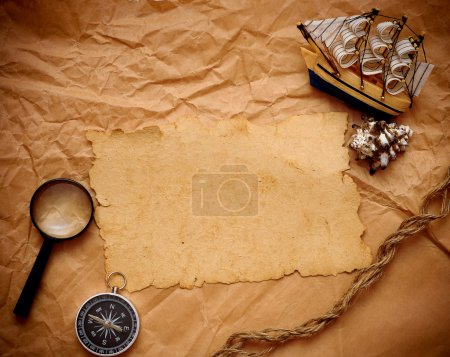 Loupe, rope and model classic boat on grunge background