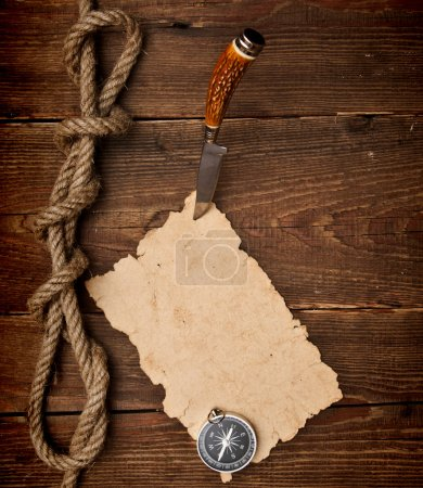 Photo for Old paper pinned to a wooden wall with a knife - Royalty Free Image