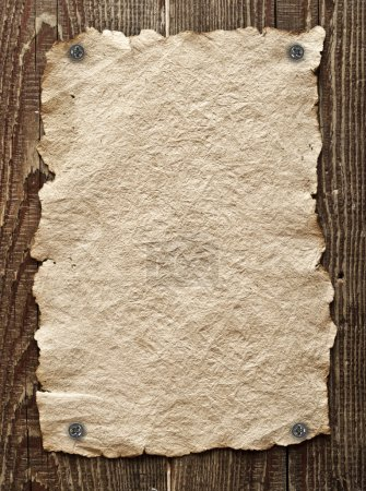 Photo for Old paper tacked to a wood wall - Royalty Free Image