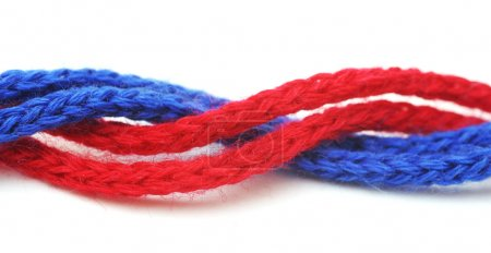 Red and blue synthetic ropes isolated on white bac...