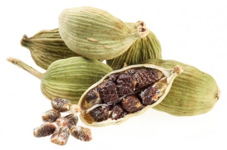 Cardamom seeds on a white background...
