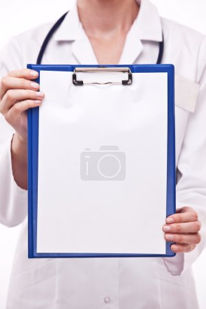 Photo for Doctor holds clipboard with empty sheet. Isolated on a white. - Royalty Free Image