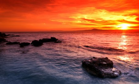 Photo for Picture of an amazing sunset over a rocky seascape in southern Greece - Royalty Free Image