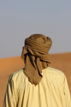 Photo for Single bedouin in a Arabic desert on a sunny day - Royalty Free Image