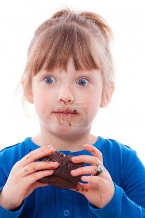 Surprised girl dirty with chocolate cake