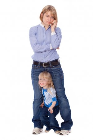 Playful child disturb mother to talk on cell looki...