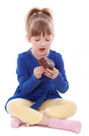 Photo for Hungry little girl eating tasty cake - Royalty Free Image