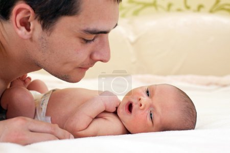 Photo for Young father looking at newborn baby boy - Royalty Free Image