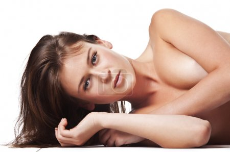 Naked woman lying on its side cross-legged