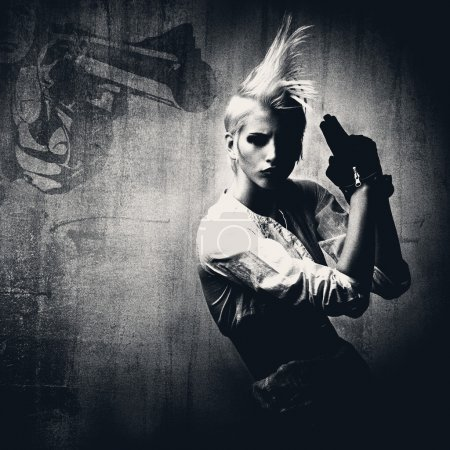 Photo for Acttractive comic blond girl with gun - Royalty Free Image