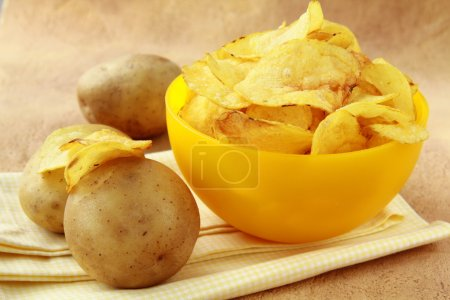 Potato chips in a yellow cup,