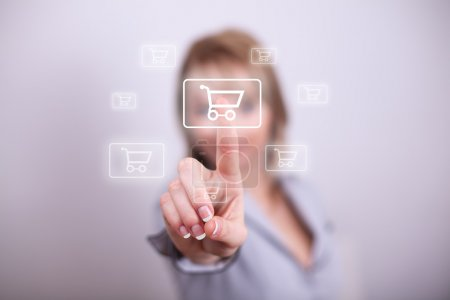 Woman pressing mdoern shopping button with one hand