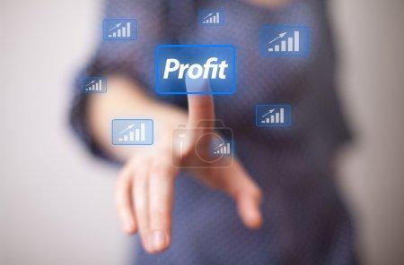 Hand pressing Profit button