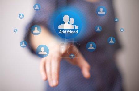 Hand pressing add friend button