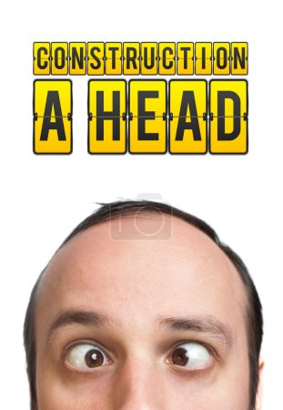 """Man with """"CONSTRUCTION A HEAD"""" mark over his head"""
