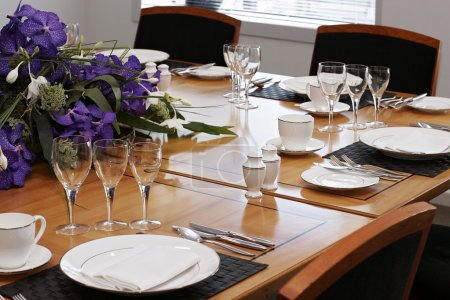 Formal dining table set up with flowers...