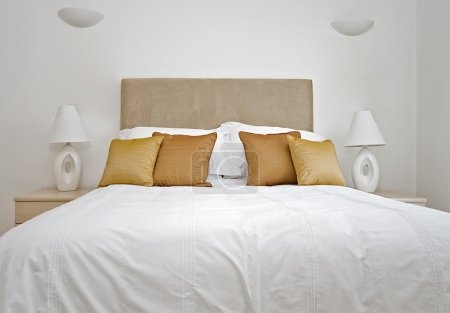 Photo for Double bed detail with bedside tables and reading lamps - Royalty Free Image