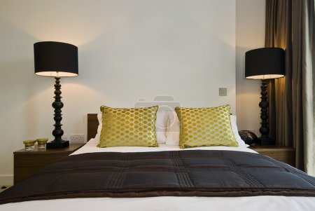Bedroom detail with satin cushions