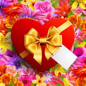 Red heart shaped gift with golden bow on flower background