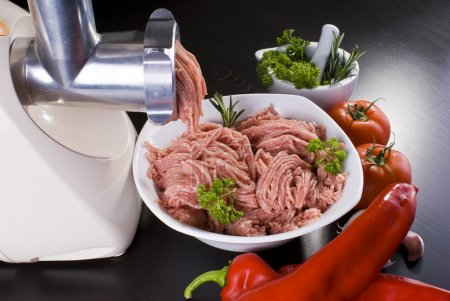 Photo for Bowl of mince with electric meat grinder and vegetables - Royalty Free Image