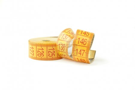 Curled measuring tape isolated on white