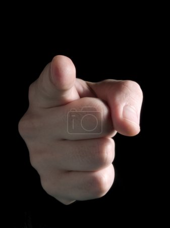 Photo for Hand pointing at observer isolated on black. - Royalty Free Image