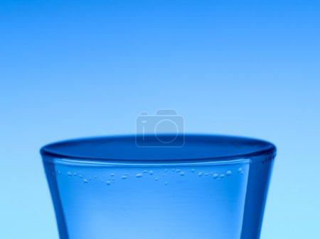 Photo for A shot of vodka on blue background. - Royalty Free Image