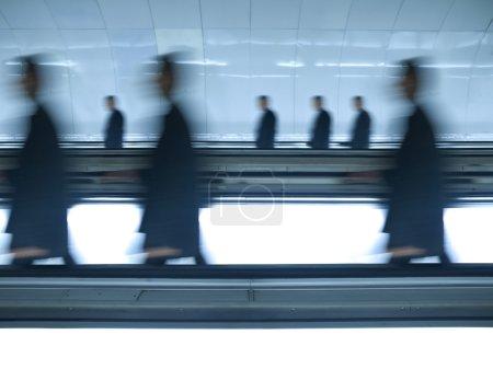 Blurred businessmen go to work
