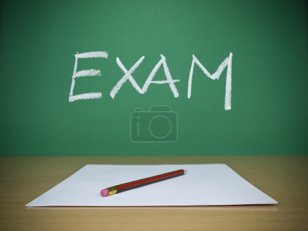 Photo for A few blank sheets ready for been filled in a exam. - Royalty Free Image