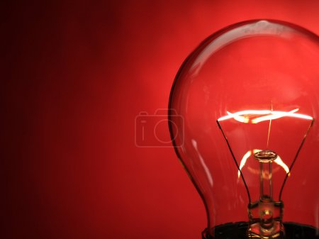 Photo for A bulb light on red background - Royalty Free Image