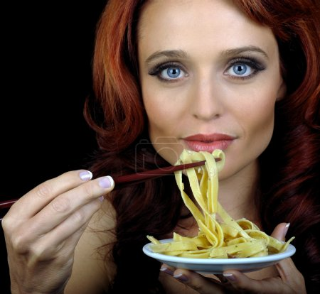 Photo for Beautiful Image Of a woman with pasta and chopsticks - Royalty Free Image