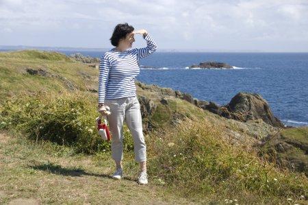 Tourist watching the ocean