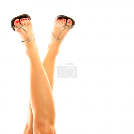 Female legs in sandals