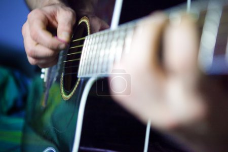 Photo for Close up image of acoustic guitar player - Royalty Free Image