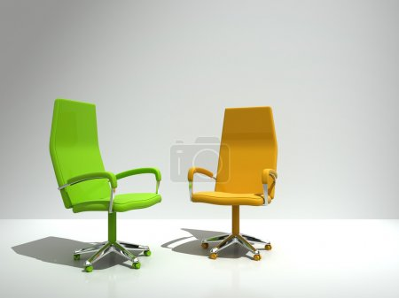 Two chairs near wall
