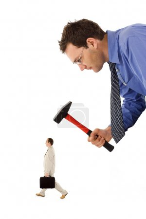 Photo for Businessman unfairly eliminating a small, rival colleague - Royalty Free Image
