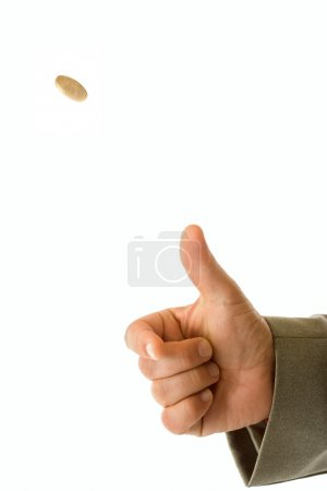 Photo for Man's hand throwing up a coin to make a decision - Royalty Free Image