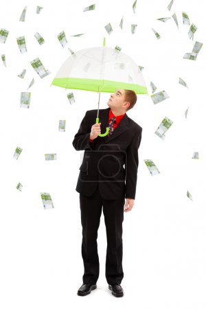 Photo for Young man under umbrella, looking up to the money rain of 100 euro banknotes - Royalty Free Image
