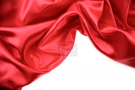 Photo for Red silk on white background. Copy space - Royalty Free Image