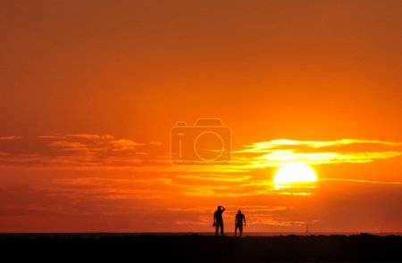 Photo for Watch the sunset at the beach - Royalty Free Image