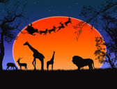 Santa Claus in Africa - silhouettes of wild animals and flying Santa