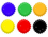 Vector illustration of bottle tops in various colours with water drops and space for your text