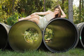 Beautiful Teen Girl Lying on a Large Pipe